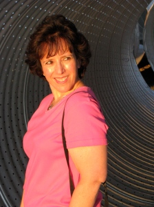 My wife Debby strikes pose in metal cylinder, which will be used to rebuild our community