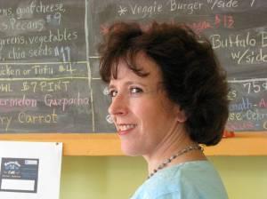Debby in front of chalkboard