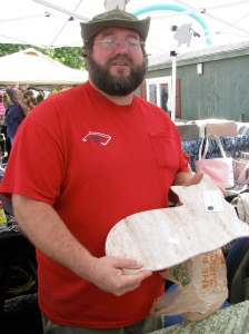 Joe Pennypacker, craftsman, holding up cutting board