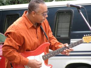 Don Butler playing Guitar